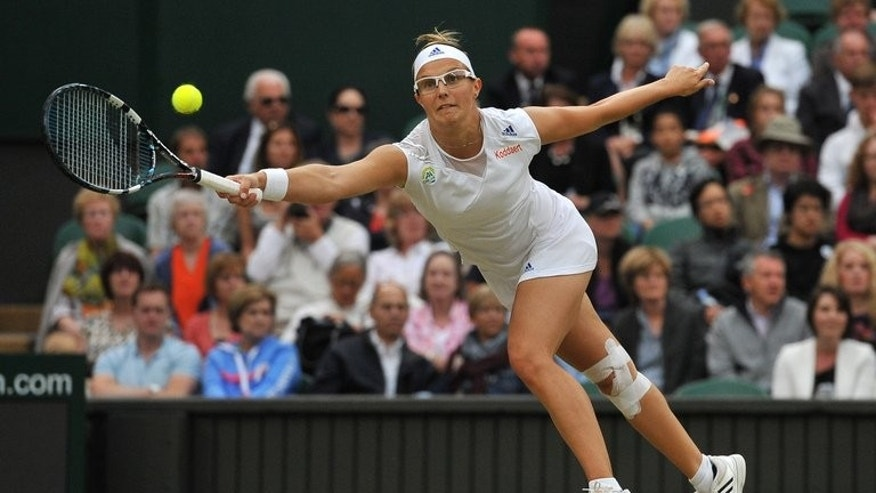 Kirsten Flipkens returns against Petra Kvitova during their Wimbledon quarter-final match on July 2, 2013. She has warned Marion Bartoli that she has no intention of letting her fairytale run at Wimbledon come to an end in Thursday's other semi-final.