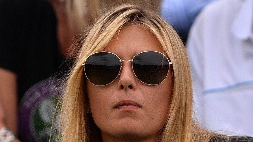 Russia's Maria Sharapova sits in the crowd watching her boyfriend Grigor Dimitrov during his second round match against Grega Zemlja at the Wimbledon tennis championships in southwest London, on June 27, 2013.
