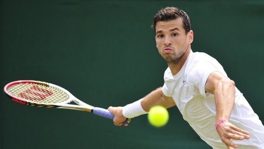 Bulgaria's Grigor Dimitrov hits a return against Slovakia's Grega Zemlja during their second round match at the Wimbledon Championships in southwest London, on June 27, 2013. Bernard Tomic, Milos Raonic and Dimitrov may be the young guns of men's tennis but at Wimbledon they were firing blanks and they all failed to reach the last eight.