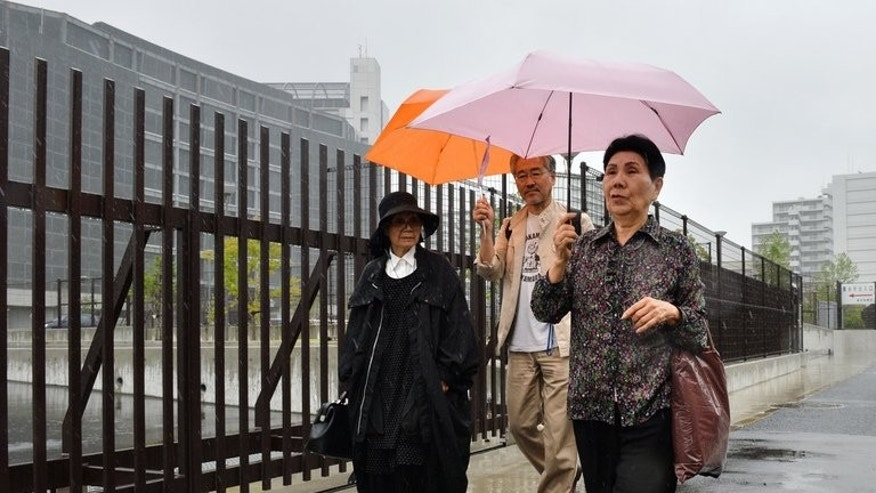 Hideko Hakamada (R), sister of Iwao Hakamada, and supporters after visiting Tokyo Detention House on May 20, 2013. Iwao Hakamada worked at a soybean processing factory about two hours east of Tokyo when he was arrested and later sentenced to death for the grisly murder of his boss and the man's family.