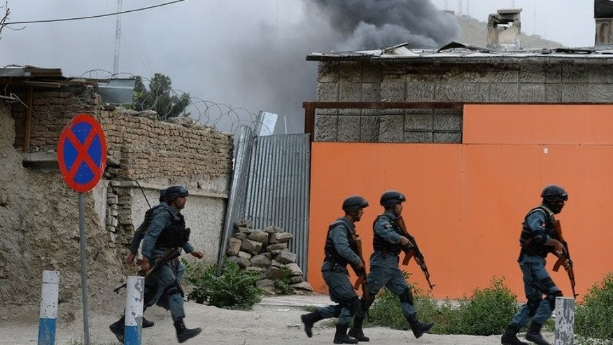 "Afghan policemen run to the site of a clash between Afghan security forces and Taliban fighters in Kabul on May 24, 2013. Pakistan on Wednesday ""categorically rejected"" remarks from the Afghan army chief alleging that it could end the 12-year conflict in Afghanistan within weeks if it was really committed to peace."