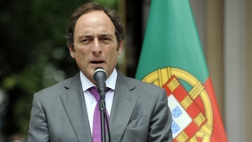 Portugal Foreign Minister Paulo Portas gives a press conference in Caracas on May 20, 2013. Portas has resigned in a row over Lisbon's bailout reforms. Portuguese Prime Minister Pedro Passos Coelho's government is tottering close to collapse after two top ministers quit, pounding financial markets in Lisbon and across Europe.