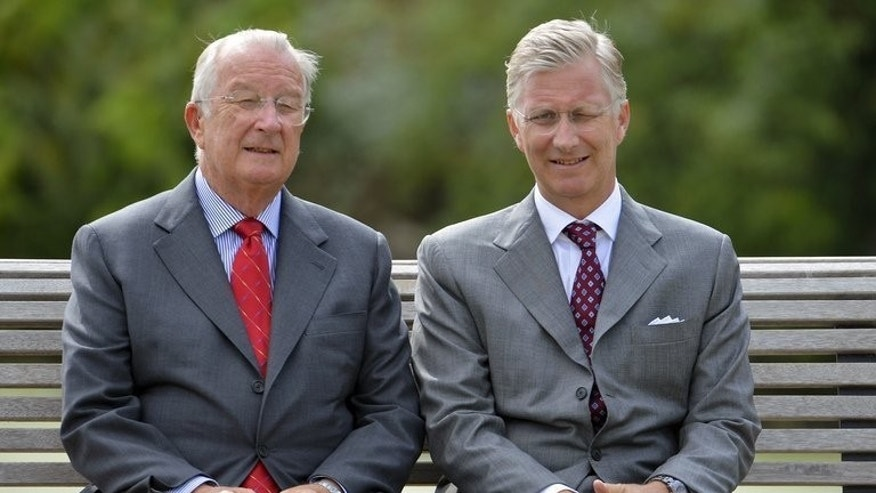 King Albert II of Belgium and Crown Prince Philippe (R) of Belgium pose at the Castle of Laeken-Laken in Brussels on September 2, 2012. Prince Philippe, destined to become the nation's seventh sovereign later this month, will face a tough challenge - to keep the divided country together.