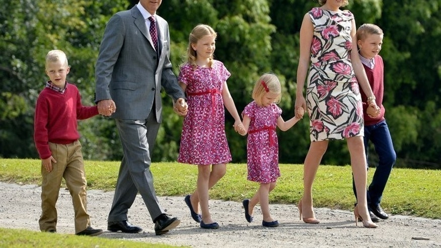 Crown Prince Philippe of Belgium (2nd to L) walks with his family at the Castle of Laeken-Laken in Brussels on September 2, 2012. Philippe and his wife Mathilde d'Udekem d'Acoz have four children including Princess Elisabeth who was born in 2001 and who is in line to be Belgium's first female successor to the throne.