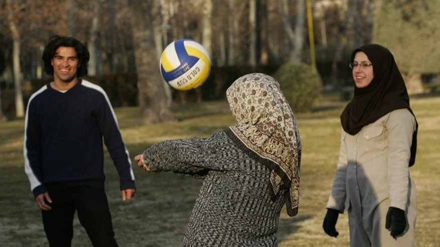Iranian youths play volleyball in a park in Tehran on January 31, 2006. Iran's volleyball triumph has created a dilemma for the state broadcaster, which is struggling to tailor its coverage of matches, attended by scantily dressed women, to the moral guidelines of the Islamic republic.