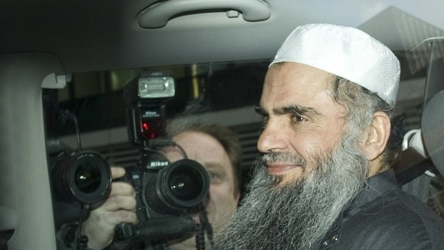 Radical Islamist cleric Abu Qatada is driven away from a Special Immigration Appeals Hearing at the High Court in London on April 17, 2012. Qatada is to be deported from Britain to Jordan on Sunday, after the two governments approved a treaty paving the way for his extradition ending years of litigation, a Jordanian official said on Wednesday.