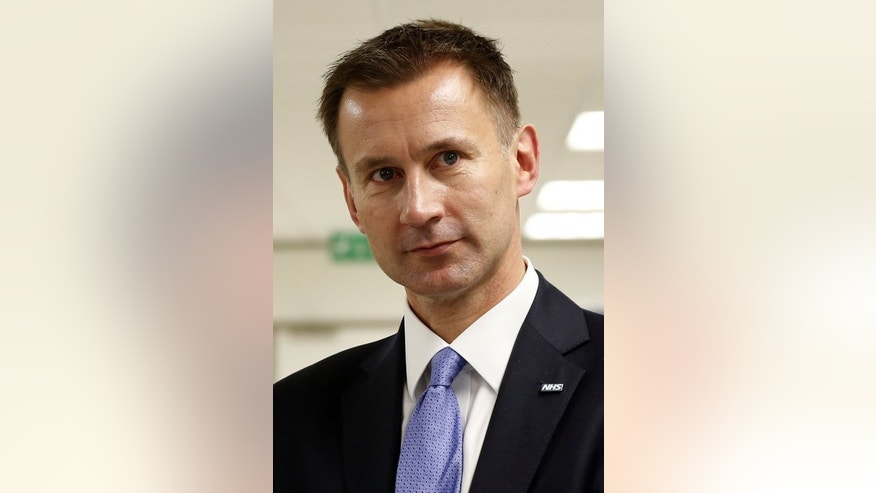 British Health Secretary Jeremy Hunt pictured during a tour of University College Hospital HQ and Education Centre in central London on June 21, 2013. Britain announced plans on Wednesday to charge migrants hundreds of pounds a year to access its state-run National Health Service (NHS), in a bid to clamp down on so-called health tourism.