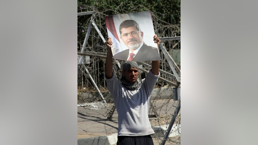 A supporter of ousted Egyptian president Mohamed Morsi, in the Rabaa el-Aadawia district of Cairo on July 4, 2013.