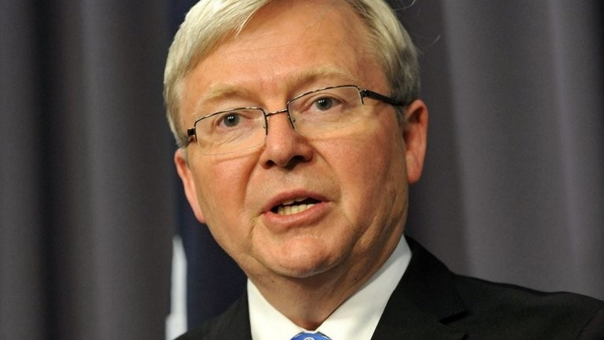 Kevin Rudd talks to the media at Parliament House, Canberra on June 26, 2013. As newly reinstated Australian Prime Minister, Rudd was to meet Indonesia's president on Friday for talks focussed on asylum-seekers with thousands defying deadly perils to try to reach Australia by sea.