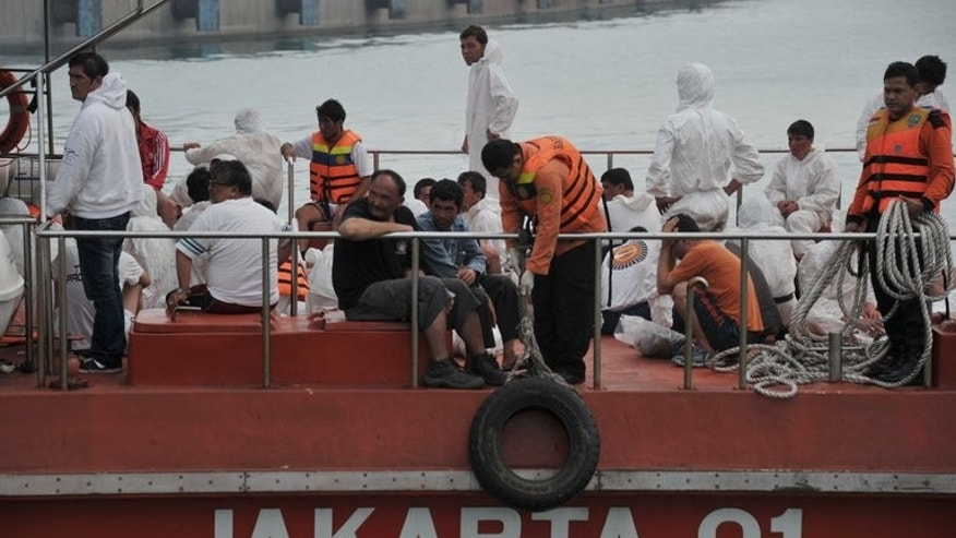 Asylum-seeker survivors are shown onboard an Indonesian rescue boat at Merak seaport on August 31, 2012. Despite Canberra's tough new policies banishing asylum-seekers to remote Pacific islands, thousands of would-be refugees continue to make the sea crossing to Australia, often from transit hubs in Indonesia.