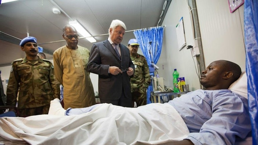 A picture released by UNAMID shows an injured UNAMID peacekeeper attacked in an ambush near Labado, East Darfur, on July 4, 2013. Attackers shot up an ambulance and wounded three Blue Helmets during an ambush in Sudan's Darfur region, the UN's peacekeeping chief said on Thursday.