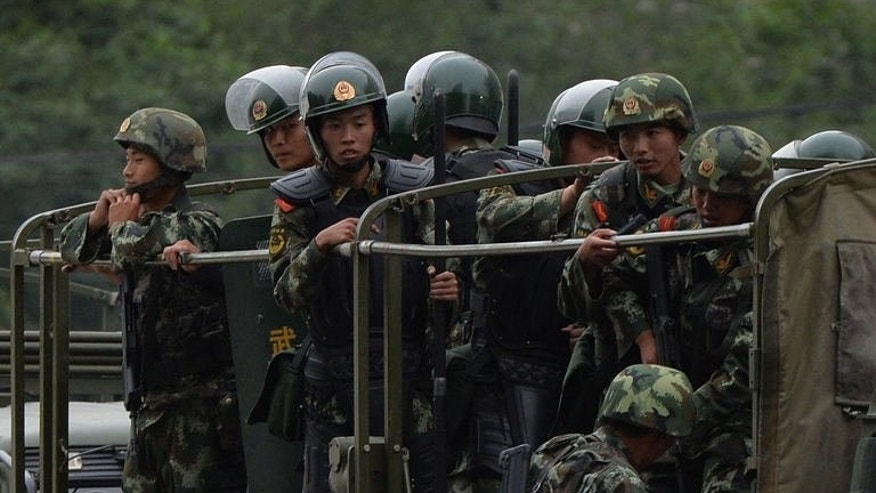 Chinese paramilitary police hold a 'show of force' ceremony in Urumqi, Xinjiang Province, on June 29, 2013. Security was ramped up in the capital of China's Xinjiang region, state media reported Friday, the fourth anniversary of ethnic clashes which killed around 200 people.