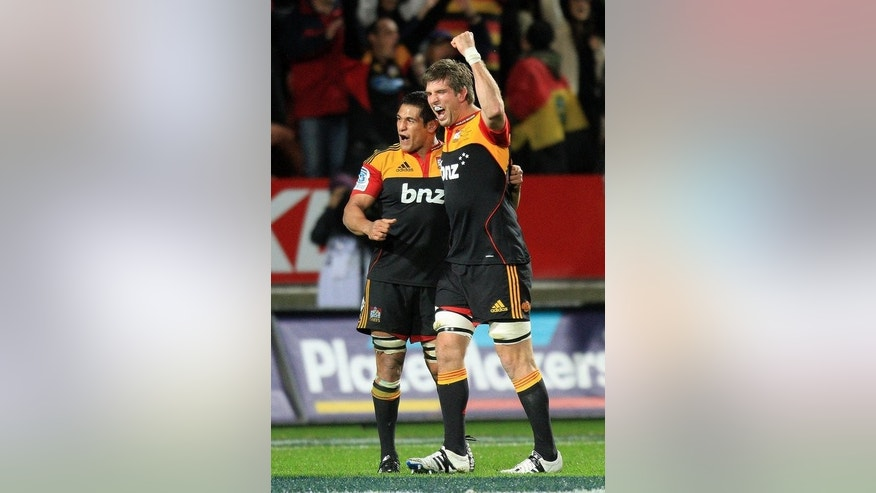 "The Waikato Chiefs' Michael Fitzgerald (R) and Tanerau Latimer celebrate win against the Coastal Sharks, in their Super 15 rugby union match at Waikato Stadium in Hamilton, on August 04, 2012. The Canterbury Crusaders say they are treating Friday's clash against the table-topping Chiefs as a ""semi-final"", as they look to secure a berth in the Super 15 play-offs."