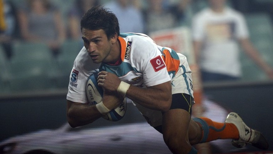 Robert Ebersohn from the Cheetahs of South Africa dives to score a try against the Waratahs of Australia during their Super 15 rugby union match at Allianz Stadium in Sydney, on March 15, 2013. The Cheetahs, who have a guaranteed four points from a bye next week, need to make amends for last week's setback at the hands of the Stormers when they play a weakened Blues side.