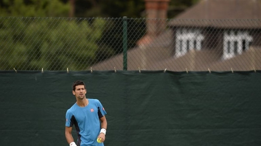 Serbia's Novak Djokovic attends a training session at the practice courts on day ten of the 2013 Wimbledon Championships at the All England Club, southwest London, on July 4, 2013, on the eve of his semi-final match against Argentina's Juan Martin del Potro. At Wimbledon this year, Djokovic is chasing a seventh major.