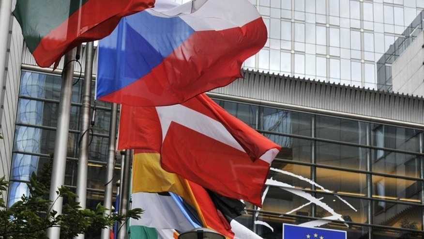 EU ambassadors were to hold talks in Brussels Thursday to agree a common stance on allegations of US spying on European premises and embassies that have sparked outrage across the bloc. File picture shows flags of the EU member states in front of the European Parliament in Brussels