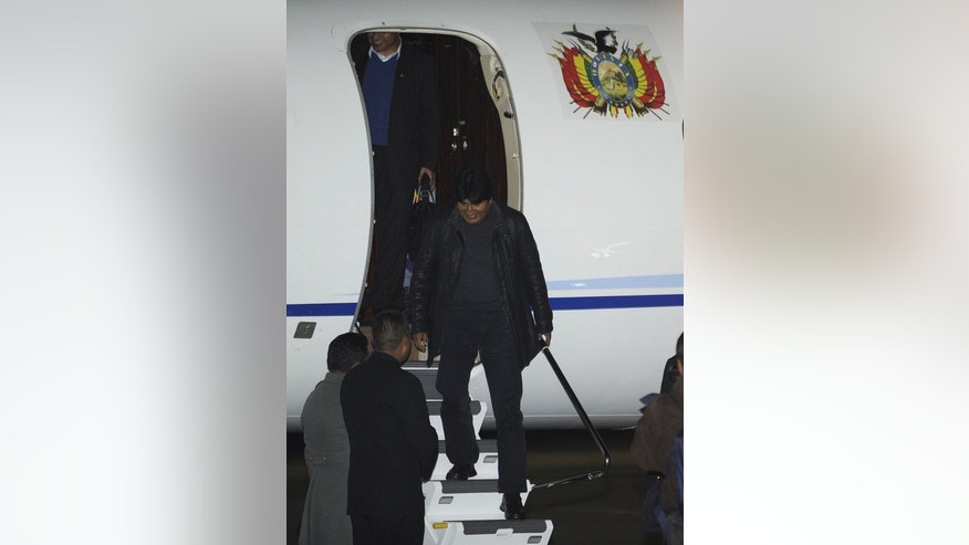 Bolivian President Evo Morales arrives at El Alto Airport on July 3, 2013 in La Paz, Bolivia. Morales's plane returning home from a trip to Moscow, was forced to make an unscheduled stopover in Vienna, where airport police searched the aircraft and confirmed that intelligence leaker Edward Snowden was not on board.