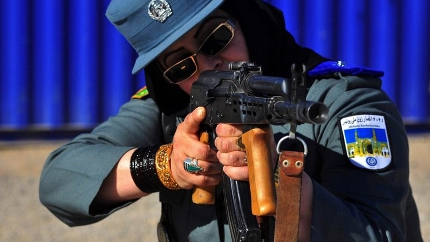 An Afghan female police officer at a shooting range on the outskirts of western Herat province, on December 8, 2011. Gunmen have shot dead one of the most high-profile female police officers in Afghanistan, underlining the threat to women who take on public roles in the country.
