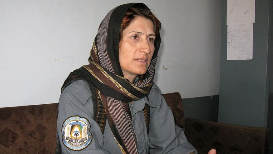 Malalai Kakar -- a senior police officer in the Afghan province of Kandahar -- answers questions during a press conference on September 25, 2008. Gunmen have shot dead Islam Bibi -- one of the most high-profile female police officers in Afghanistan -- underlining the threat to women who take on public roles in the country.