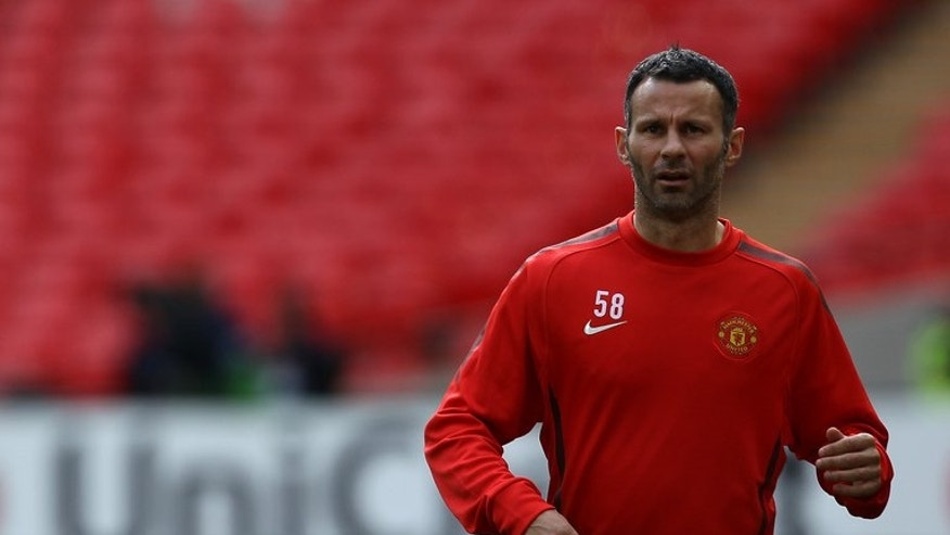 Manchester United midfielder Ryan Giggs part in a training session in London on May 27, 2011. Manchester United announced that Giggs is to take on a player-coach role with the English Premier League champions next season.