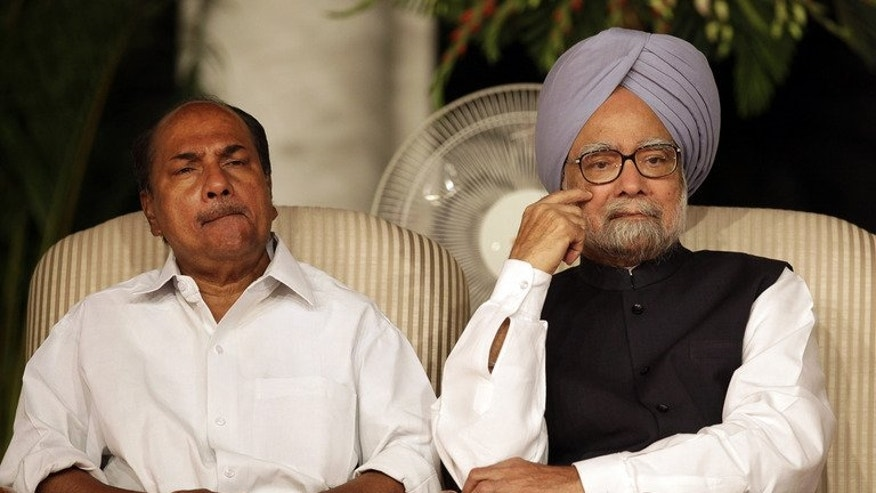 Indian Prime Minister Manmohan Singh (R) and Defense Minister A.K. Antony are shown in New Delhi on May 22, 2013. A.K. Antony is expected to meet his Chinese counterpart during a three-day visit to China, and discussions are likely to include peace on their shared border as well as regional security issues, reports here said.
