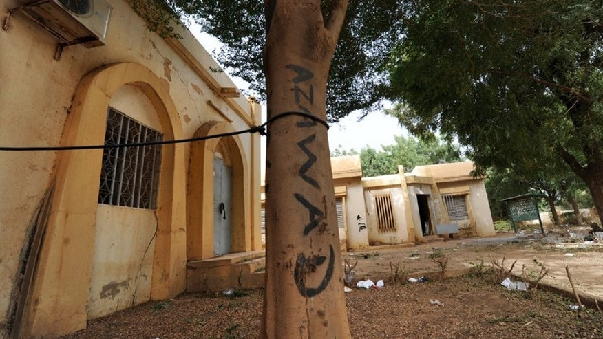 The name of the MNLA group is seen written on a tree on February 1, 2013, in front of the Gao town hall. Mali's parliament said Thursday it had stripped immunity from prosecution from nine lawmakers including six suspected of terrorism and weapons- and drug-trafficking as part of an armed rebel group. The six are said to have joined minority Tuareg separatist groups including MNLA.