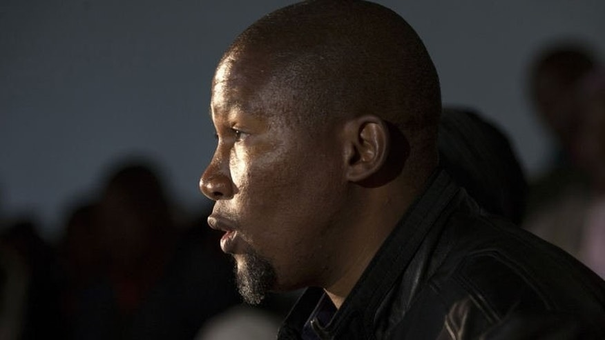Nelson Mandela's grandson, Mandla Mandela, holds a press conference at his home in Mvezo on July 4, 2013. He hit back in a bitter family quarrel, launching a tirade against his close relatives after he was ordered to return the remains of his grandfather's children.