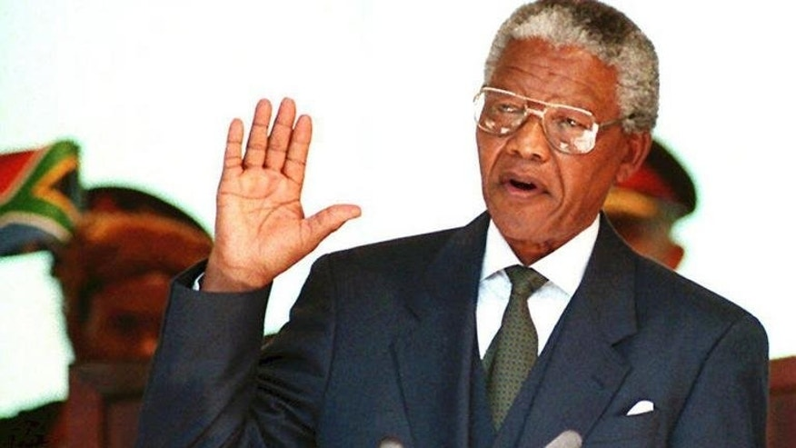 "Nelson Mandela is sworn in as South Africa's president on May 10, 1994 in Pretoria. Haunted by death during his long anti-apartheid struggle, Mandela looked toward his own ""eternal sleep"" as a man who fulfilled his duty to his people."