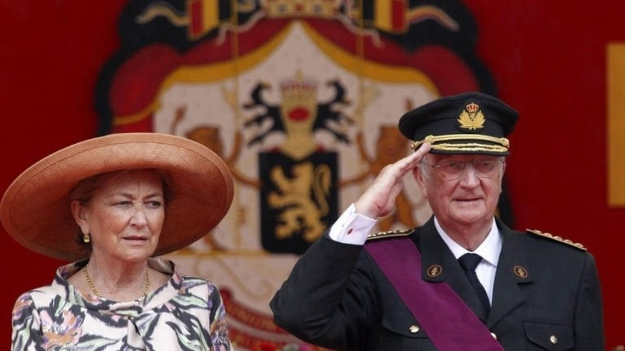King Albert II and Queen Paola of Belgium watch a military parade in Brussels, July 21, 2011. Belgian King Albert, 79, became the latest to announce he will abdicate his throne, a little over a week after the emir of Qatar Hamad ben Khalifa Al Thani stepped down in favour of his son -- a first for an Arab country.