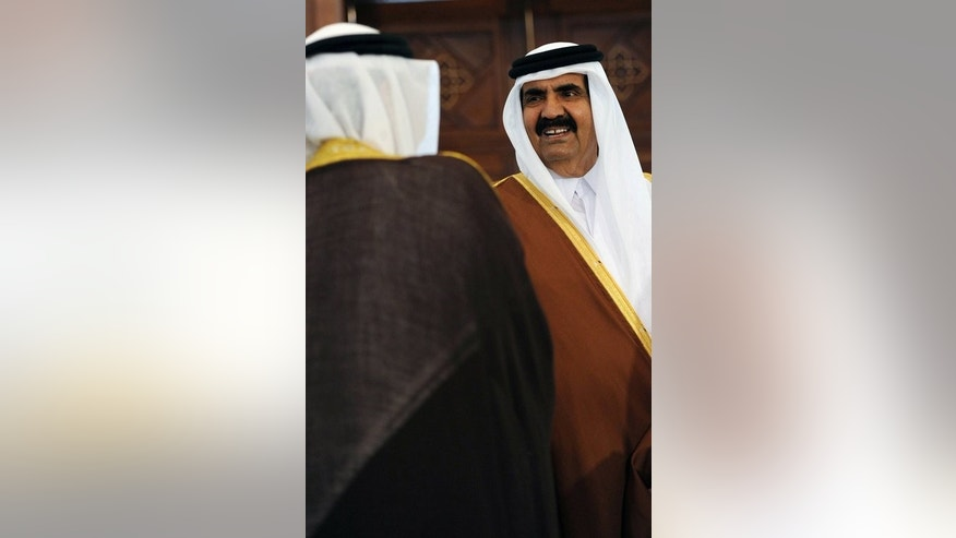 The Emir of Qatar, Sheikh Hamad Ben Khalifa al-Thani arrives at the Boumediene airport on January 7, 2012 in Algiers. In June 2013, Al Thani stepped down in favour of his son -- a first for an Arab country.