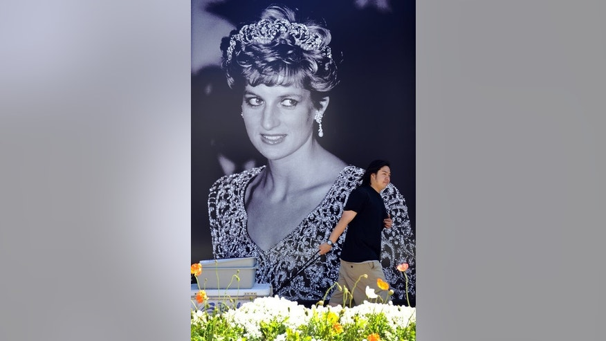 "A man walks in front of a portrait Princess Diana in Beverly Hills, California on April 26, 2011. Diana's human touch made her a potent symbol; she was described as the ""people's princess"" and said she wanted to be ""queen of people's hearts""."