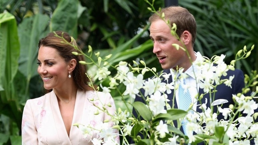 Prince William and his wife Catherine with an orchid hybrid named after Princess Diana in Singapore on September 11, 2012. Both women have endured one of the biggest challenges of being a modern royal: constant scrutiny from the press.