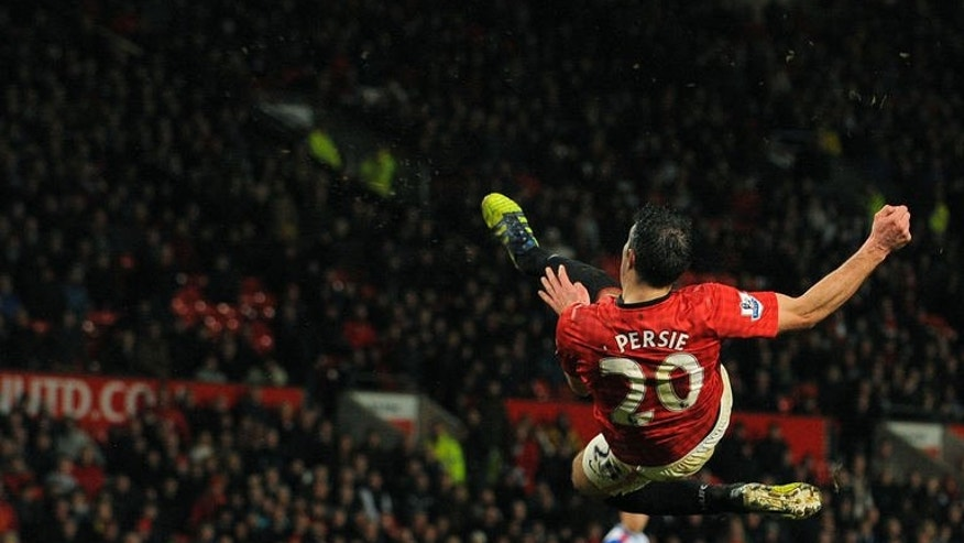 Manchester United's Robin van Persie shoots during the match against Reading at Old Trafford on March 16, 2013. The new team manager David Moyes took training for the first time on Thursday and although he has less than a week to prepare the squad for their five-game tour of Asia and Australia, he has already given strong indications that he intends to lead the club on his own terms.