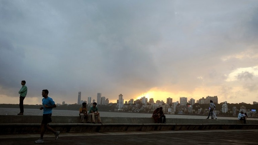 The sun sets over of Mumbai on September 7, 2012. A two-storey building housing apartments and garment makers has collapsed near Mumbai, killing one person, police said Thursday -- the fifth deadly collapse around the Indian financial capital in the past few months.