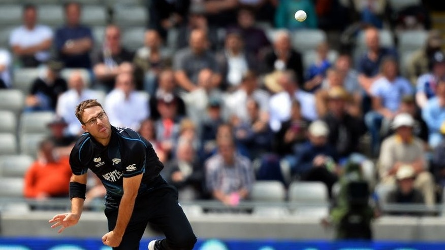 New Zealand's Daniel Vettori delivers a ball during a 2013 ICC Champions Trophy match at Edgbaston in Birmingham, central England, on June 12, 2013. Injury-plagued spinner announced on Friday he will be sidelined for at least six months but refused to call time on an international career stretching back 16 years.