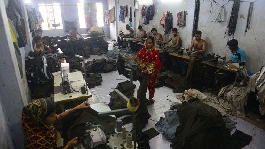 Bangladeshi labourers work in a small garments factory on the outskirts of Dhaka on May 29, 2013. Only one in 10 garment factory buildings inspected by engineers from a top Bangladesh university were structurally sound, underlining the scale of safety problems for the world's second-biggest clothes producer, the head engineer said