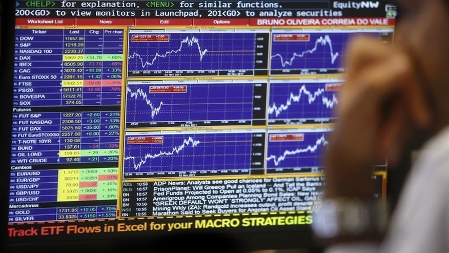 A trader looks at a computer screen during trading operation in Lisbon on November 2, 2011. Portugal's leaders scrambled to save their coalition government after being torpedoed by top resignations over the austerity policies squeezing the bailed-out nation.