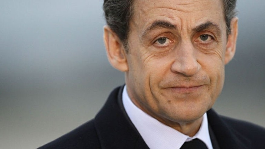 A photo taken on March 2, 2012 shows France's President Nicolas Sarkozy at the military airport of Villacoublay outside Paris. Sarkozy on Thursday resigned from France's top constitutional body after it upheld a decision that he had exceeded official spending limits during last year's election campaign.