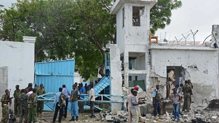 Soldiers are pictured at the scene of an attack by Shebab insurgents on the UN compound in Mogadishu on June 19, 2013. For the past year, many celebrated that Somalia's Shebab fighters were on the back foot -- but analysts warn the extremist group is far from defeated.