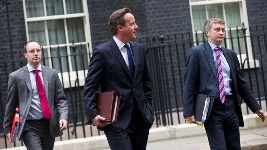 British Prime Minister David Cameron (C) leaves 10 Downing Street in London on June 19, 2013, for parliament. Lawmakers will on Friday vote on whether to move the country a step closer to an in-out referendum on its membership of the European Union by 2017.