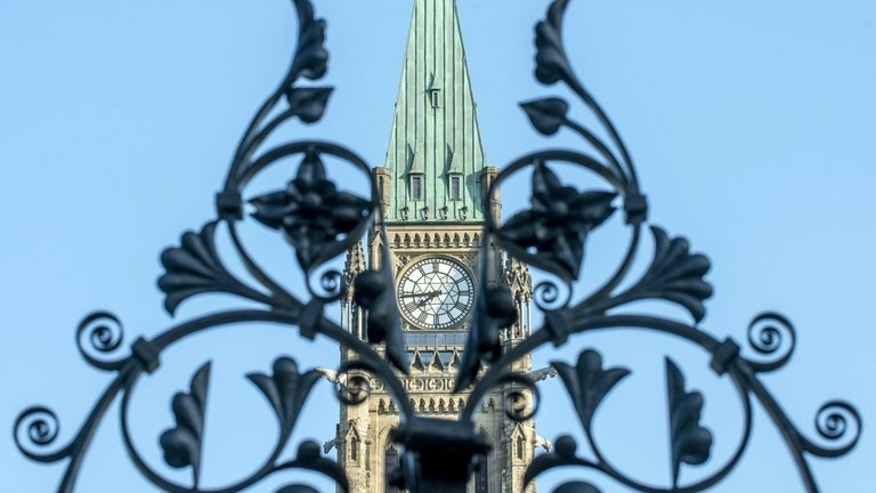 The clock of the Canadian Parliament is viewed on August 16, 2012, in Ottawa, Ontario. Canada's jobless rate held steady at 7.1 percent in June, the government's statistics agency said Friday.