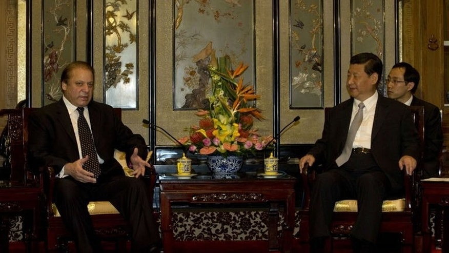"Pakistan Prime Minister Nawaz Sharif (L) talks to Chinese President Xi Jinping at the Diaoyutai State guest house in Beijing on July 4, 2013. Sharif says Pakistan's relationship with China is ""sweeter than honey"", during his visit to Beijing with economic ties at the top of the agenda."