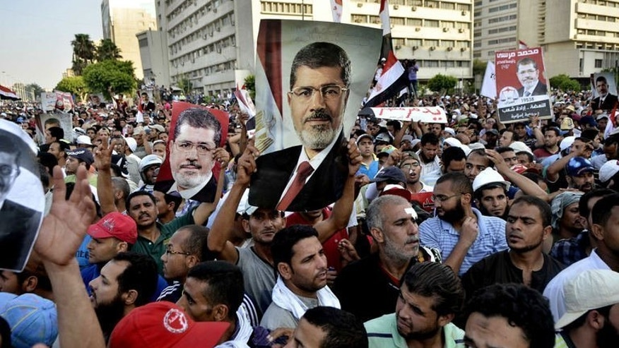 Egyptian supporters of the Muslim Brotherhood march in support of ousted president Mohamed Morsi in Cairo on July 5, 2013. The military coup in Egypt has starkly illustrated the failure of Islamist parties elected in the wake of the Arab Spring to adapt to the practicalities of power and respond to popular expectation, analysts say.