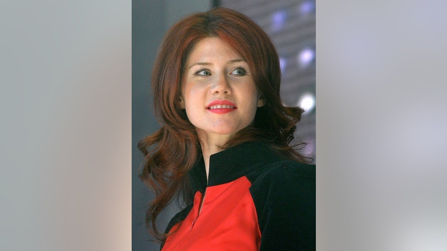 Former Russian spy Anna Chapman attends a congress of a pro-Kremlin youth group on December 22, 2010. Chapman has proposed marriage to US intelligence leaker Edward Snowden, who is stuck without documents in a Moscow airport, in an increasingly bizarre turn of events that unleashed excitement in Russia.
