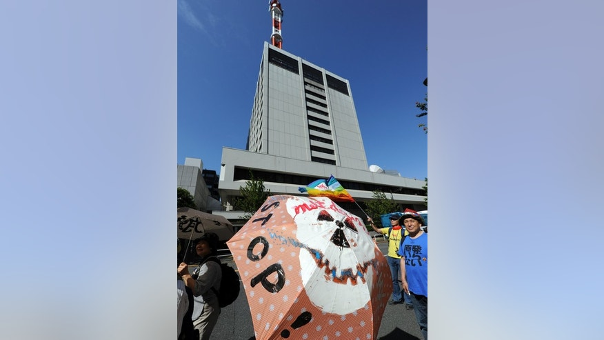 Protesters march in front of the Tokyo Electric Power (TEPCO) headquarters against nuclear power plants, following the March 2011 Fukushima meltdown-disasters, in Tokyo on June 2, 2013.