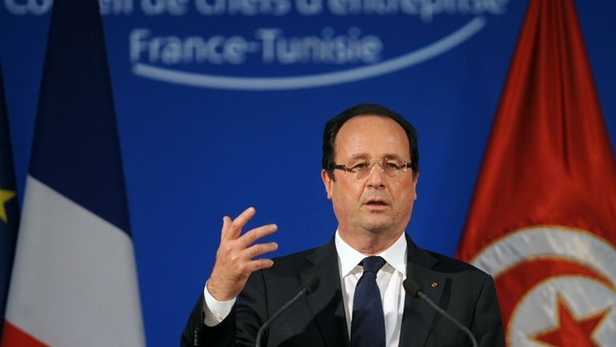"French President Francois Hollande gives a speech at the headquarters of Tunisia's union of industry, commerce and crafts (UTICA) in Tunis, on July 5, 2013. Hollande reaffirmed his confidence in the ""new Tunisia"" during the first trip by a French president since the January 2011 revolution which brought an Islamist-led government to power, and as political turmoil swept Egypt."