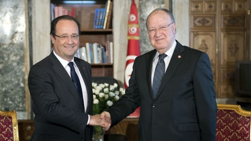 French President Francois Hollande (L) shakes hands with Tunisia's National Constituent Assembly President Mustapha Ben Jaafar at the Constituent Assembly in Tunis on July 5, 2013.