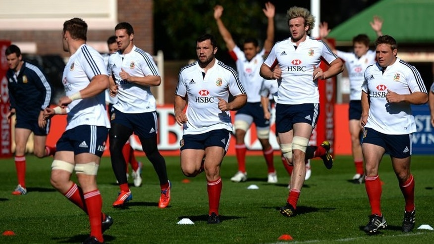 British and Irish Lions players engage in warm-up exercises during the captain's run in Sydney, on July 5, 2013. The Lions assist. coach Graham Rowntree has thrown down the gauntlet to the Wallabies ahead of July 6, showdown declaring ???we???re ready for the battle.???