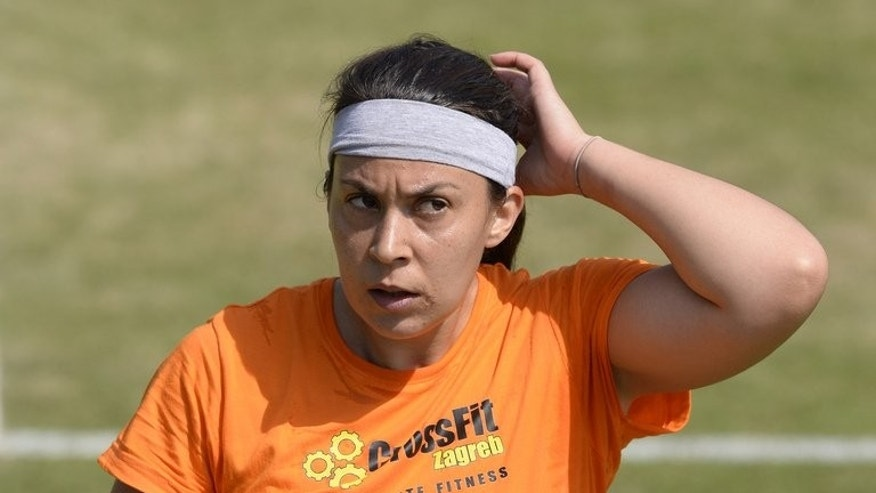 France's Marion Bartoli attends a training session on day eleven of the Wimbledon Championships, at the All England Club, southwest London, on July 5, 2013, on the eve of her women's singles final match against Sabine Lisicki.