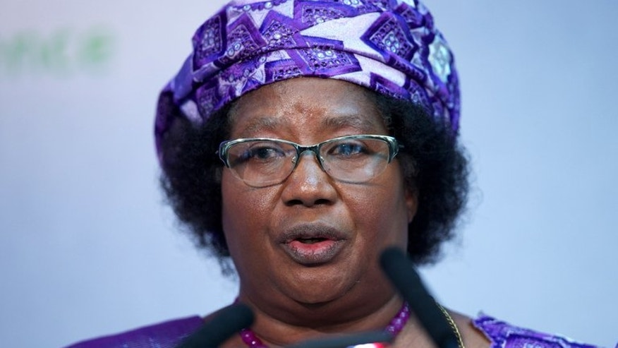 President of Malawi Joyce Banda, pictured in central London on June 8, 2013, gave a candid glimpse into the stresses of office, admitting that thinking of the plethora of problems including widespread poverty could drive her mad.